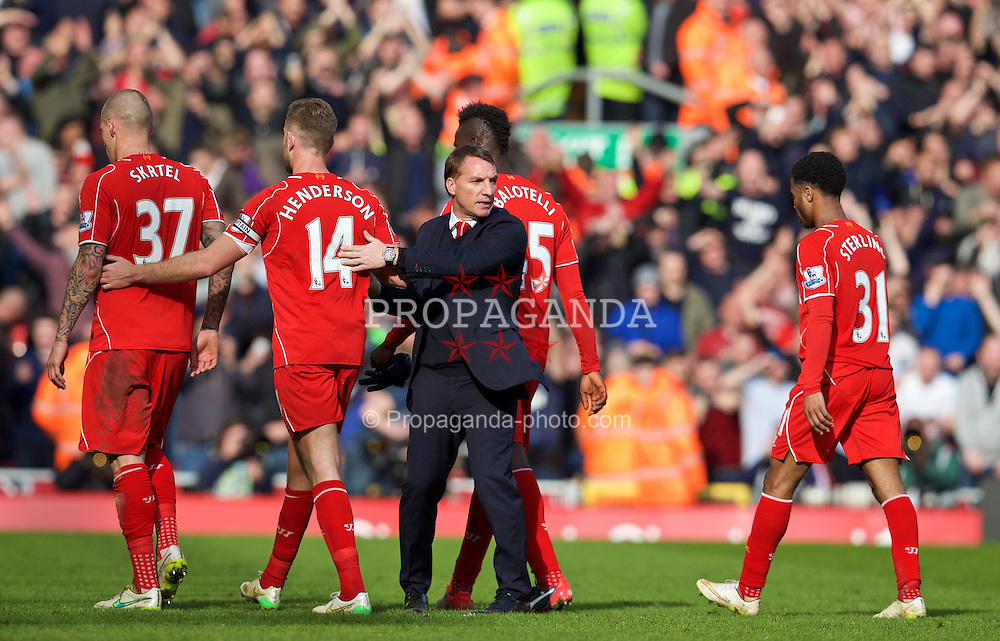 LIVERPOOL, ENGLAND - Sunday, March 22, 2015: Liverpool's manager Brendan Rodgers shakes hands with captain Jordan Henderson after the 2-1 defeat by Manchester United during the Premier League match at Anfield. (Pic by David Rawcliffe/Propaganda)