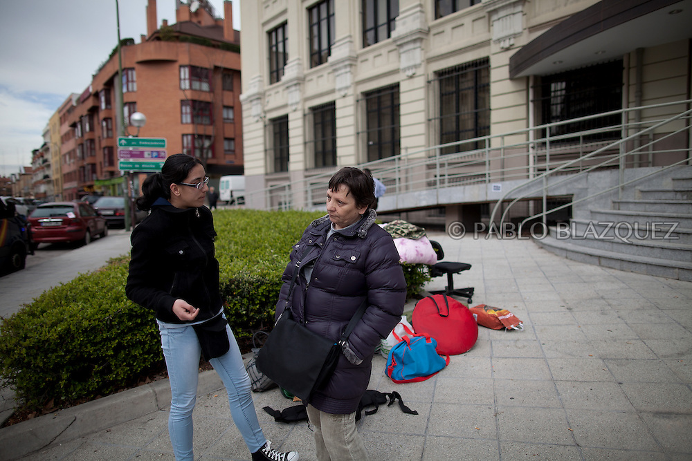 Amalia Torres 51, (R) and friend stand next to their belongings one day before her eviction takes place outside the Madrid's Council Housing Office where she spent the night claiming to stop her eviction on April 3, 2013 in Madrid, Spain. The Mortgage Holders Platform (PAH) and other anti evictions organizations are organizing 'escraches' since several weeks ago outside Popular Party deputies houses and offices to demand the vote for a Popular Legistative Initiative (ILP) to stop evictions, regulate dation in payment and social rent.
