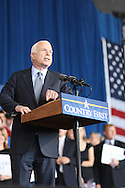 US Republican presidential nominee Senator John McCain (R-AZ) motions with his hand has he speaks at a campaign rally in Cedar Rapids, Iowa, September 18, 2008.