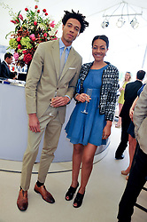 CHARLIE CASELY-HAYFORD and his sister ALICE CASELY-HAYFORD at the St.Regis International Polo Cup between England and South America held at Cowdray Park, West Sussex on 18th May 2013.  South America won by 11 goals to 9 goals.