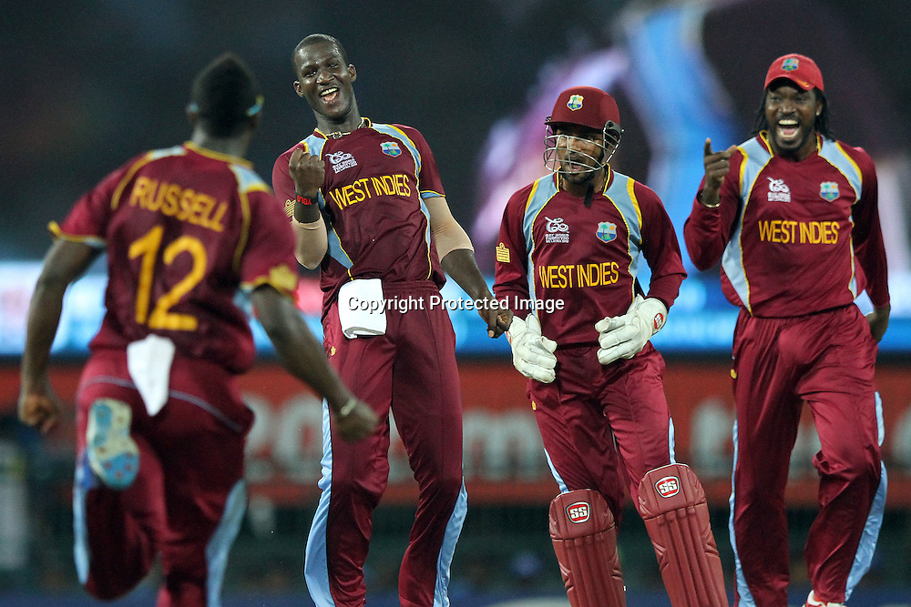 West Indies bowler Darren Sammy (2L) and team mates celebrate the dismissal of Sri Lanka&rsquo;s Kumar Sangakkara during the ICC World Twenty20 final between Sri Lanka and the West Indies held at the Premadasa Stadium in Colombo, Sri Lanka on the 7th October 2012.<br /> <br /> Photo by Sanka vidanagama/SPORTZPICS/PHOTOSPORT