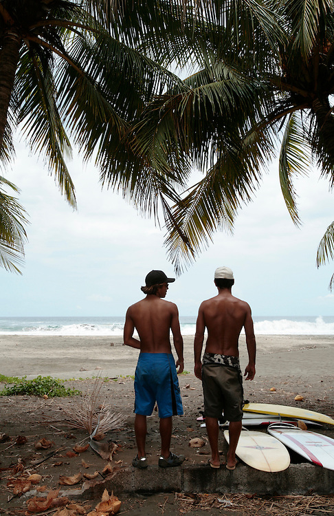 Two surfers scan the waves in Marbella, Costa Rica.