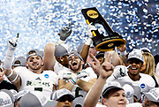 Members of the Northwest Missouri football team celebrate winning  the NCAA Division II National Championship against Shepherd, Saturday, Dec. 19, 2015, in Kansas City, Kan. Missouri defeated Shepherd 34-7. (AP Photo/Colin E. Braley)
