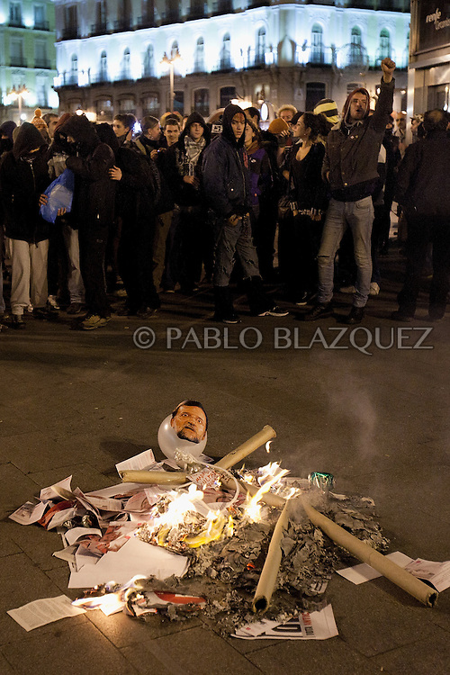 Protesters burn a rag doll depecting Spain's opposition Partido Popular (PP) party leader Mariano Rajoy at the Puerta del Sol square in Madrid on November 20, 2011, after the first results of the general election were announced. Spain's right stormed to its biggest election win ever, unleashing dancing in the street by voters desperate for an end to soaring unemployment and a eurozone debt storm.Mariano Rajoy, the bearded 56-year-old leader of the conservative Popular Party, literally jumped for joy as he proclaimed victory. ( Pablo Blazquez Dominguez )