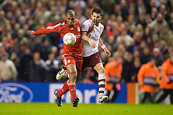 LIVERPOOL, ENGLAND - Tuesday, April 8, 2008: Liverpool's Ryan Babel breaks through on goal past Arsenal's Cesc Fabregas to score the fourth goal during the UEFA Champions League Quarter-Final 2nd Leg match against Arsenal at Anfield. (Photo by David Rawcliffe/Propaganda)