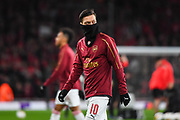 Arsenal Midfielder Mesut Ozil (10) warms-up ahead of the Europa League round of 16, leg 2 of 2 match between Arsenal and Rennes at the Emirates Stadium, London, England on 14 March 2019.