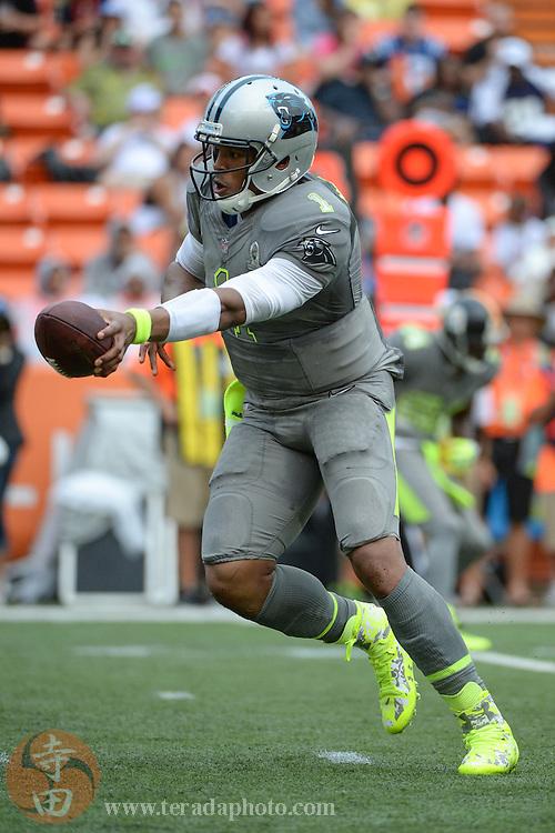 January 26, 2014; Honolulu, HI, USA; Team Sanders quarterback Cam Newton of the Carolina Panthers (1) hands the football off during the third quarter of the 2014 Pro Bowl at Aloha Stadium. Team Rice defeated Team Sanders 22-21.