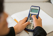 A student uses a remote to participate in a science exercise at Cunningham Elementary School, May 14, 2015.