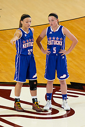 Kentucky Girls All-Star Kaylee Cotton, left, talks at center court with Kentucky Girls All-Star Whitney Creech during the first half. The Kentucky vs. Indiana All-Star Classic was held, Sunday, June 12, 2016 at Knights Hall in Louisville.