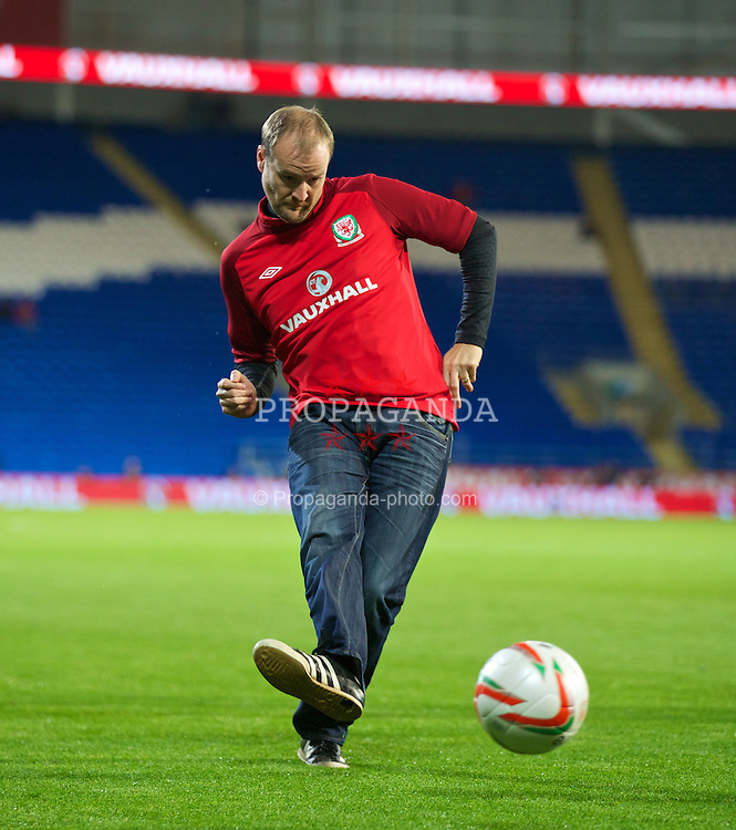 CARDIFF, WALES - Tuesday, September 10, 2013: Vauxhall competition winners take part in a half-time penalty shoot out during the 2014 FIFA World Cup Brazil Qualifying Group A match between Wales and Serbia at the Cardiff CIty Stadium. (Pic by David Rawcliffe/Propaganda)