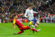 England defender Ben Chilwell is brought down by Montenegro midfielder Deni Hočko during the UEFA European 2020 Qualifier match between England and Montenegro at Wembley Stadium, London, England on 14 November 2019.
