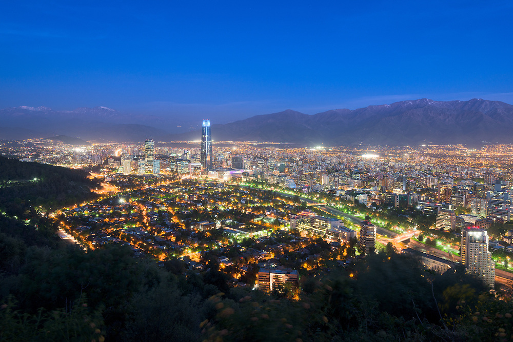 Panoramic view at night of Santiago de Chile with The Andes Mountain Range in the back