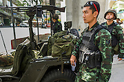 "20 MAY 2104 - BANGKOK, THAILAND:  Thai soldiers at a checkpoint on Rama I Road in Bangkok after the Thai army declared martial law. The army declared martial law throughout Thailand in response to growing political tensions between anti-government protests led by Suthep Thaugsuban and pro-government protests led by the ""Red Shirts"" who support ousted Prime Minister Yingluck Shinawatra. Despite the declaration of martial law, daily life went on in Bangkok in a normal fashion. There were small isolated protests against martial law, which some Thais called a coup, but there was no violence.   PHOTO BY JACK KURTZ"