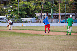 John Browne takes a swing after a pitch from Hugh Reifer.  Players of the 40 and over cricket team practice for an upcoming tournament at Addelita Cancryn field.  St. Thomas, USVI.  14 April 2015.  © Aisha-Zakiya Boyd