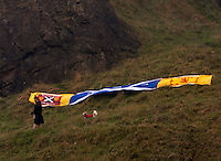A scott lie his flag on the top of Arthur Seat.<br /> Members of different political ideal gather in the scottish parliament due what Today 18th September is the Scottish Referendum. Pako Mera/Universal News And Sport (Europe) 18/09/2014