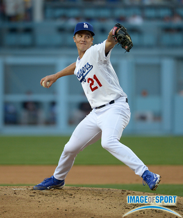 Apr 6, 2014; Los Angeles, CA, USA; Los Angeles Dodgers starter Zack Greinke (21) delivers a pitch against the San Francisco Giants at Dodger Stadium.