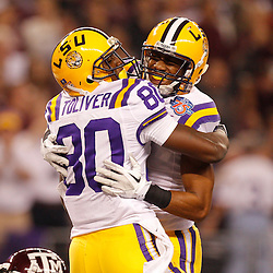 Jan 7, 2011; Arlington, TX, USA; LSU Tigers wide receiver Terrence Toliver (80) celebrates with teammate wide receiver Rueben Randle (2) following a touchdown against the Texas A&M Aggies during the first quarter of the 2011 Cotton Bowl at Cowboys Stadium.  Mandatory Credit: Derick E. Hingle