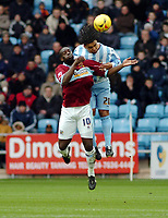 Photo: Kevin Poolman.<br />Coventry City v Burnley. Coca Cola Championship. 25/02/2006.<br />Burnley's Michael Ricketts (L) and Richard Shaw fight in the air for the ball.