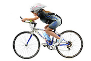 8 year old triathlete Shannon Varenhorst on her bicycle in studio on white background