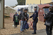 Nov. 11, 2015 - Wegscheid, Bavaria, Germany - GERMANY, Bavaria, Wegscheid; <br /> <br /> An Austrian official checks that an asylum seeker has a wristband with his number on it, prior to crossing the border here into Germany.  The number relates to his place in the queue and bus he is designated to.<br /> ©Exclusivepix Media