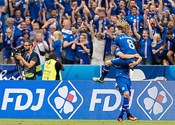 23.06.2016, Stade de France, St. Denis, FRA, UEFA Euro 2016, Island vs Oesterreich, Gruppe F, im Bild Jubel, Arnor Ingvi Traustason (ISL), Birkir Bjarnason (ISL) // Celebration of Arnor Ingvi Traustason (ISL) Birkir Bjarnason (ISL) during Group F match between Iceland and Austria of the UEFA EURO 2016 France at the Stade de France in St. Denis, France on 2016/06/23. EXPA Pictures © 2016, PhotoCredit: EXPA/ JFK