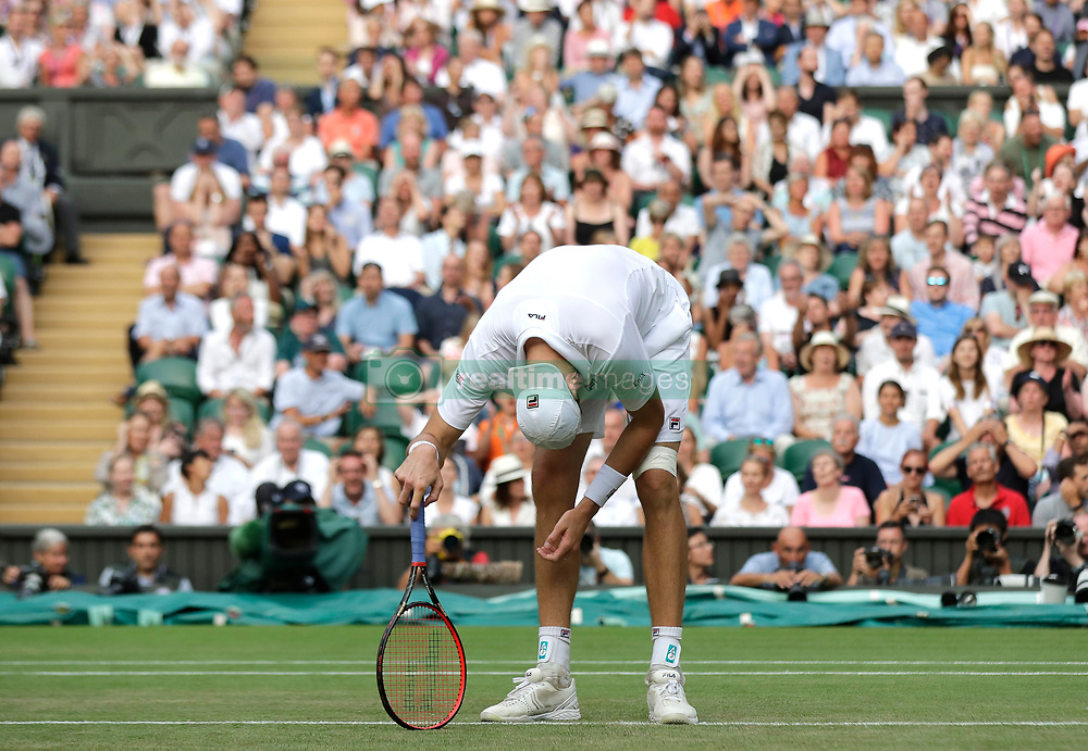 John Isner reacts on day eleven of the Wimbledon Championships at the All England Lawn Tennis and Croquet Club, Wimbledon.