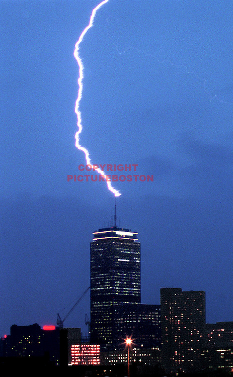 Boston,MA  Lightning seems to be striking the top of the Prudential Center tower. Mark Garfinkel photo