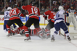 Mar 29; Newark, NJ, USA; Tampa Bay Lightning left wing Ryan Malone (12) scores his 3rd goal of the game past New Jersey Devils goalie Martin Brodeur (30) during the second period at the Prudential Center.