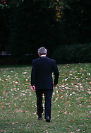 President George W. Bush walks back to the  Oval Office after  a South Lawn event on November 12, 2008.  Photograph by Dennis Brack