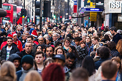 "London, December 23rd 2014. Dubbed by retailers as the ""Golden Hour"" thousands of shoppers use their lunch hour to do some last minute Christmas shopping in London's West End. PICTURED: Thousands of Christmas shoppers keep the retail bonanza going."