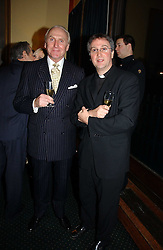 Left to right, CHRISTOPHER LAWRENCE-PRICE and FATHER MICHAEL SEED at a reception to support The Hyde Park Appeal at the Officers Mess, Hyde Park Barracks, London SW1 on 24th January 2007.<br /><br />NON EXCLUSIVE - WORLD RIGHTS