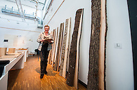 Furniture conservation professor Charlotta Ekholm wirth sample pieces of wood that will be on display as part of a teacher-curated exhibition focusing on surface materials.
