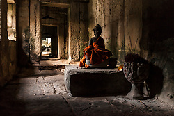 Aug. 2, 2013 - Buddha statue at the Ta Prohm Temple ruins at  Angkor Wat, Siem Reap, Cambodia (Credit Image: © Gary  Latham/Cultura/ZUMAPRESS.com)