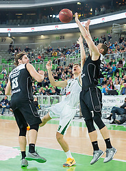 Blaz Mesicek #9 of KK Union Olimpija between Giorgios Bogris and Alex Ruoff of Bilbao during basketball match between KK Union Olimpija Ljubljana and Bilbao Basket (ESP) in Round #9 of EuroCup 2015/16, on December 9, 2015 in Arena Stozice, Ljubljana, Slovenia. Photo by Vid Ponikvar / Sportida