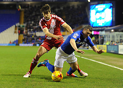 Middlesbrough's George Friend fouls Birmingham City's Paul Caddis - Photo mandatory by-line: Dougie Allward/JMP - Mobile: 07966 386802 - 18/02/2015 - SPORT - Football - Birmingham - ST Andrews Stadium - Birmingham City v Middlesbrough - Sky Bet Championship