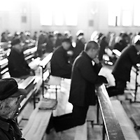 DONGLU, 11 MARCH 2001: men and women are seated seperately during mass.China cut relations with the Vatican in the early fifites .. and since then, established a Patriotic catholic Church that's controlled by Chinese authorities.<br />Catholics who refused to give up their ties with the Vatican, started worshipping in underground churches and consequently were persecuted for a long time. Since the late nineties though, relations with the Vatican informally started to improve. Although China still has no diplomatic relations, many representatives from official churches met the pope John Paull II secretely . The Vatican, under the pope's leadership, has made several efforts to recover the tie with China. In February 2006 , Hong Kong Bishop Joseph Zen was named one of the first 15 new cardinals, which is seen by many as a gesture of goodwill and a significant step towards recovering the Vatican-China relationship.