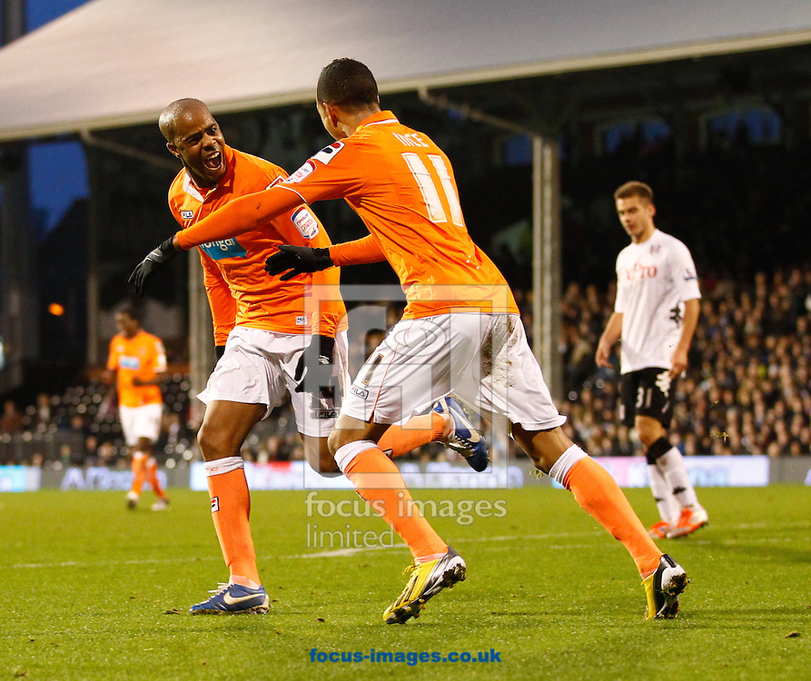 Picture by Andrew Tobin/Focus Images Ltd +44 7710 761829.05/01/2013.Ludovic Sylvestre of Blackpool celebrates with Thomas Ince of Blackpool after scoring their first goal  during the The FA Cup match at Craven Cottage, London.
