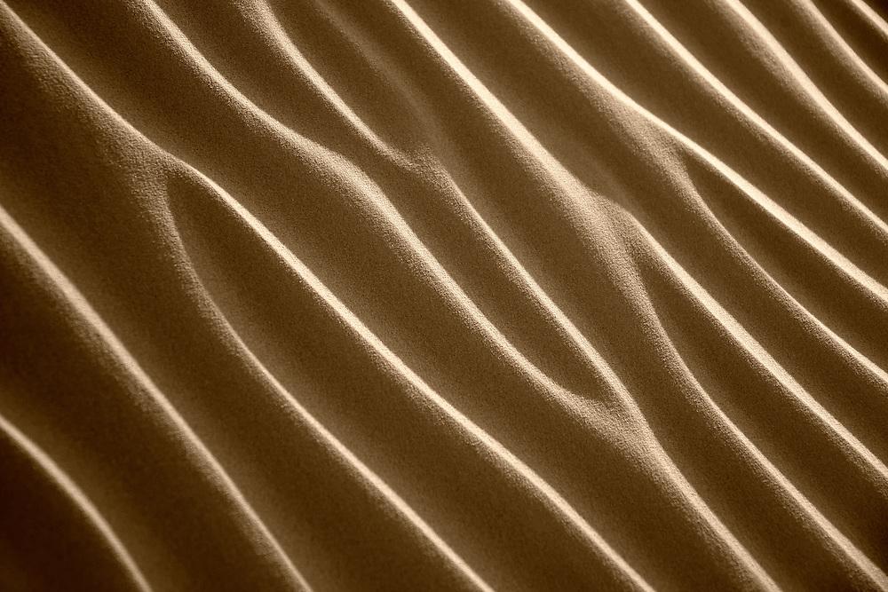 An image of desert sand pattern from the Sahara desert in Morocco.