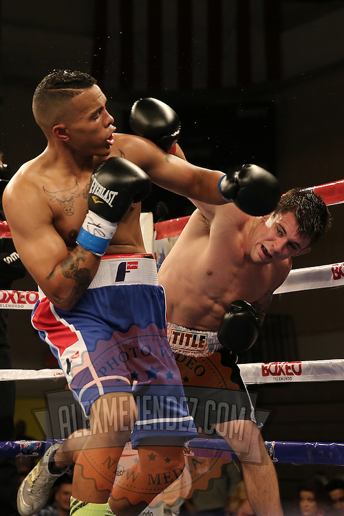 KISSIMMEE, FL - MARCH 06:  Anthony Way (R) and Fernando Martinez trade punches during the Telemundo Boxeo boxing match at the Kissimmee Civic Center on March 6, 2015 in Kissimmee, Florida. (Photo by Alex Menendez/Getty Images) *** Local Caption *** Fernando Martinez; Anthony Way