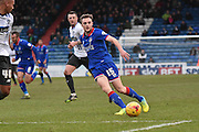 Oldham Athletic Midfielder, Carl Winchester crosses the ball during the Sky Bet League 1 match between Oldham Athletic and Bury at Boundary Park, Oldham, England on 23 January 2016. Photo by Mark Pollitt.