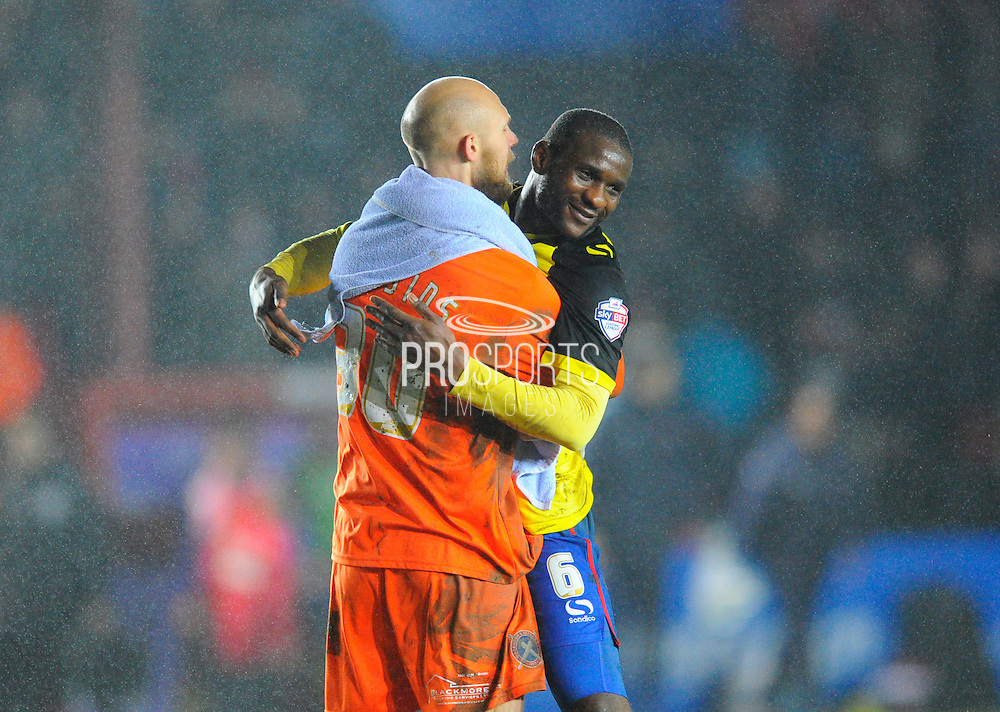 Dagenham & Redbridge's Mark Cousins and Dagenham & Redbridge's Clevid Dikamona celebrate the teams win after the final whistle during the Sky Bet League 2 match between Exeter City and Dagenham and Redbridge at St James' Park, Exeter, England on 2 January 2016. Photo by Graham Hunt.