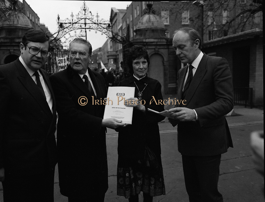 "Irish Theatre Industry Protest at Leinster House.1983.07.12.1983.12.07.1983.7th December 1983...With the imposition of a 23% V.A.T.rate on theatre tickets, the theatre industry was feeling the strain. Maureen potter and Brendan Grace aka ""Bottler"" led the protest to the gates of Leinster House Dublin...Image as a protest document is handed to Fianna Fail T.D.s Burke and   Kennedy."
