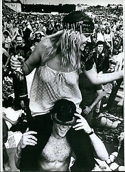 1972 - Open air festival at Nuremberg/West Germany; About 70,000 fans, from all over west Germany as well as from other European countries came to Nuremberg/West Germany last week end, visiting the super rock festival, which took place there at the Zeppelinfeld. A lot of famous groups - like ''The Who'', the ''Steve Gibbons Band'', ''Scorpions'' (Wet Germany), ''AC/DC'' (Australia) and ''Cheap Trick'' (USA), Miriam Makeba and others - gave performance there for about 13 hours. It was a peaceful festival. Photo Shows Open Air Pleasure very happy spectators. (Credit Image: © Keystone Pictures USA/ZUMAPRESS.com)