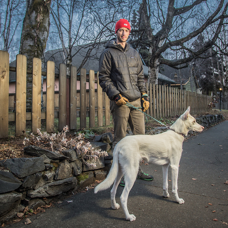 Pharmacist Brian Haviland and his dog, Lola, on H Street in Anchorage's South Addition neighborhood