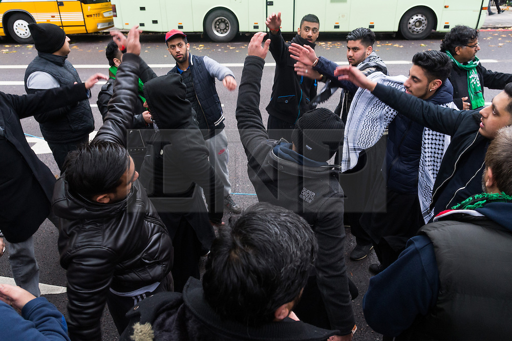 CAPTION CORRECTION © Licensed to London News Pictures. 20/11/2016. Muslim men take part in the annual Arbaeen procession,  which marks a sacred Shia Muslim ritual. Arbaeen, also known as Chehlum, commemorates the end of the 40-day mourning period after the killing of Imam Hussein, the Prophet Muhammad's grandson, in a battle in 680 AD. His martyrdom is considered a defining event in the schism between Sunni and Shia Muslims. London, UK. Photo credit: Ray Tang/LNP