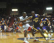 """Mississippi guard Nick Williams (20) is defended by Alcorn State's Tony Eakles (30) at the C.M. """"Tad"""" Smith Coliseum in Oxford, Miss. on Thursday, December 29, 2010. (AP Photo/Oxford Eagle, Bruce Newman)"""