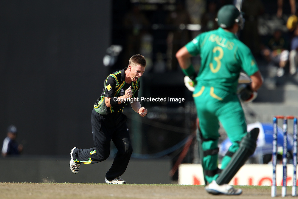 Xavier Doherty celebrates the wicket of Jacques Kallis during the ICC World Twenty20 Super 8s match between Australia and South Africa held at the Premadasa Stadium in Colombo, Sri Lanka on the 30th September 2012<br /> <br /> Photo by Ron Gaunt/SPORTZPICS