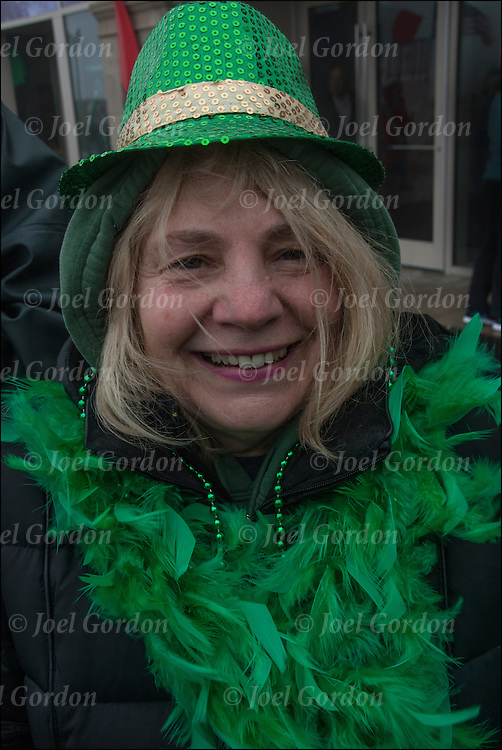 Smiling woman one of the many faces of Irish Ethnic Pride  in the crowd for the 29th annual St.Patrick Day Parade in Atlantic City on the boardwalk.