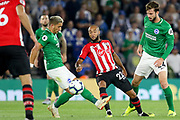 Brighton and Hove Albion midfielder Anthony Knockaert (11) battles with Southampton midfielder Nathan Redmond (22) during the Premier League match between Southampton and Brighton and Hove Albion at the St Mary's Stadium, Southampton, England on 17 September 2018.