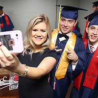 Lakyn Kirk, an English teacher at Nettleton High School, gets her picture with Alex Grooms and Austin Gray as the Nettleton graduating class of 2019 gets ready for thier ceremony backstage at the BancorpSouth Arena on Saturday.